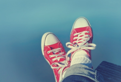 Feet Crossed - Relaxation and Satisfaction - Red Sneakers